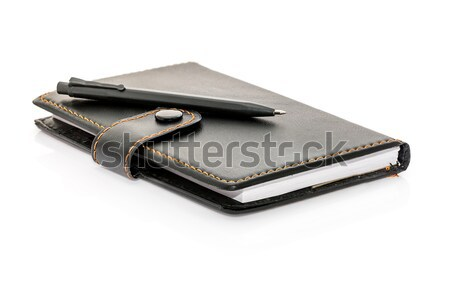 Pen put on the notebook Stock photo © stoonn