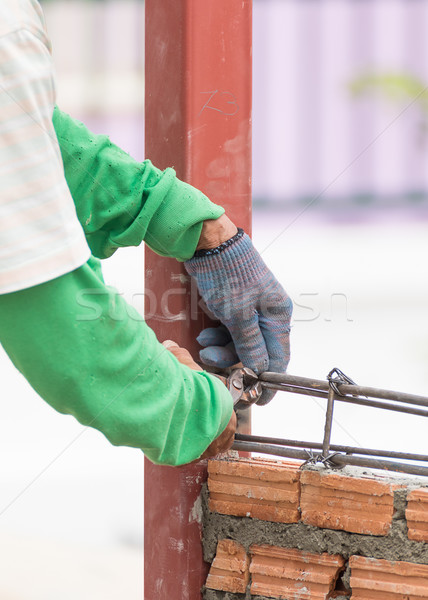 Workers using steel wire and pincers rebar before concrete is po Stock photo © stoonn