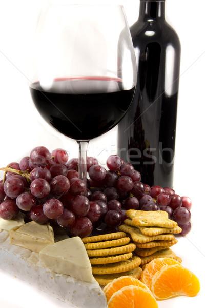 Bouteille vin rouge raisins photos autour fond Photo stock © Stootsy
