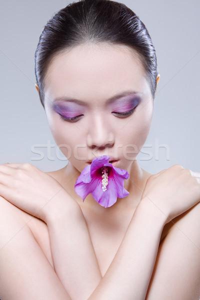 Mulher flor boca asiático pesado make-up Foto stock © stryjek