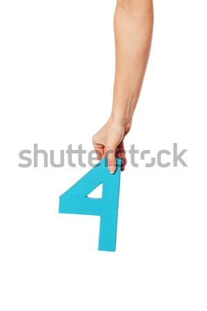 hand holding up the letter T from the top Stock photo © stryjek