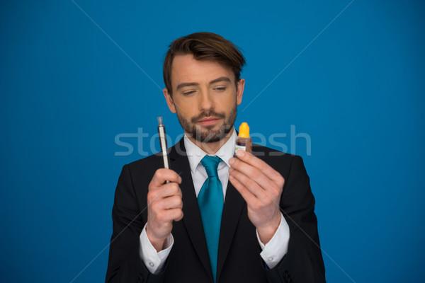 üzletember tart kék férfi biztonság férfi Stock fotó © stryjek