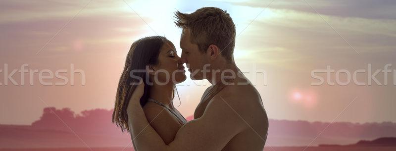 Casal romântico pôr do sol beijo Foto stock © stryjek