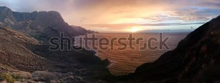 Colorful sunset over a tranquil coastline Stock photo © stryjek