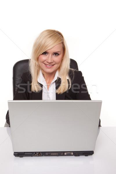 Smiling secretary at her laptop Stock photo © stryjek