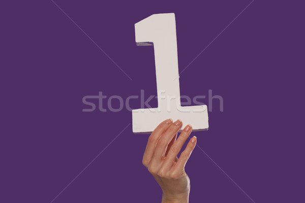 Female hand holding up the number 1 from the bottom Stock photo © stryjek