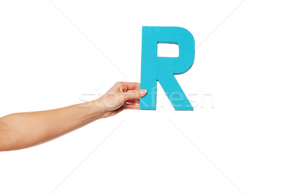 hand holding up the letter R from the left Stock photo © stryjek