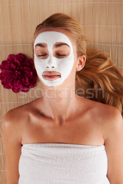 Woman with a face mask in a spa Stock photo © stryjek