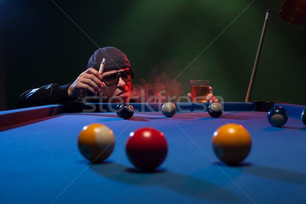 Man playing pool in a club smoking e-cigarette Stock photo © stryjek