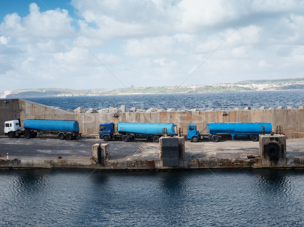 Tankers lined up on a cement wharf Stock photo © stryjek