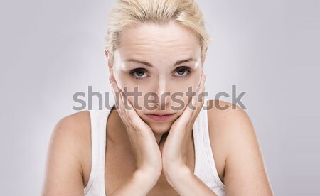 Portré kaukázusi szőke nő fogfájás szürke lány Stock fotó © stryjek