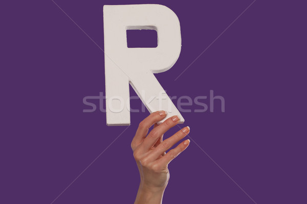 Female hand holding up the letter R from the bottom Stock photo © stryjek