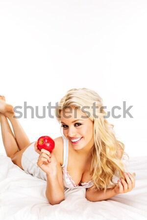 блондинка яблоко красивой красное яблоко кровать Сток-фото © stryjek