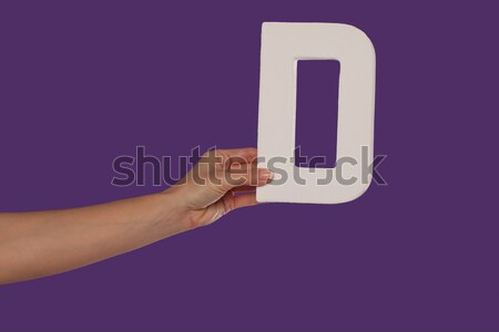 Female hand holding up the letter U from the left Stock photo © stryjek