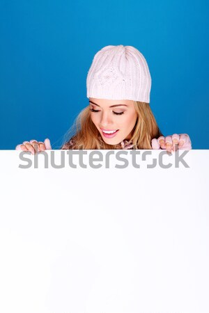 Laughing Girl Looking Down At Blank Sign Stock photo © stryjek