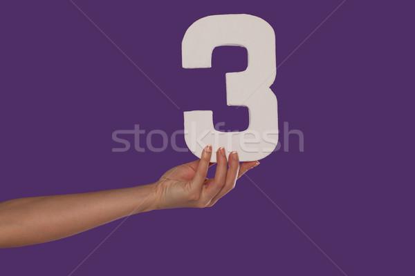 Vrouwelijke hand aantal paars nummers Stockfoto © stryjek