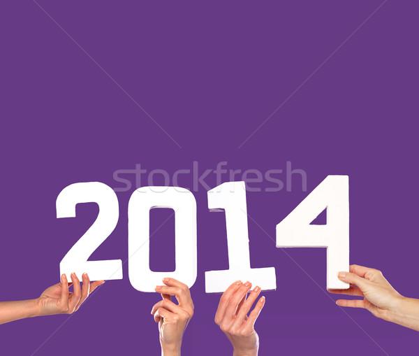 2014 capodanno biglietto d'auguri viola femminile mani Foto d'archivio © stryjek