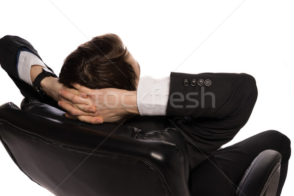 Relaxed businessman sitting in a comfortable chair Stock photo © stryjek