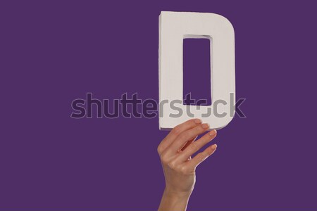 Female hand holding up the letter D from the bottom Stock photo © stryjek