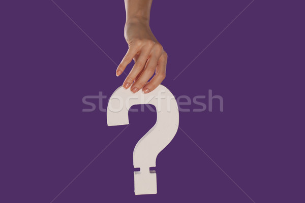 Female hand holding up a question mark from the top Stock photo © stryjek