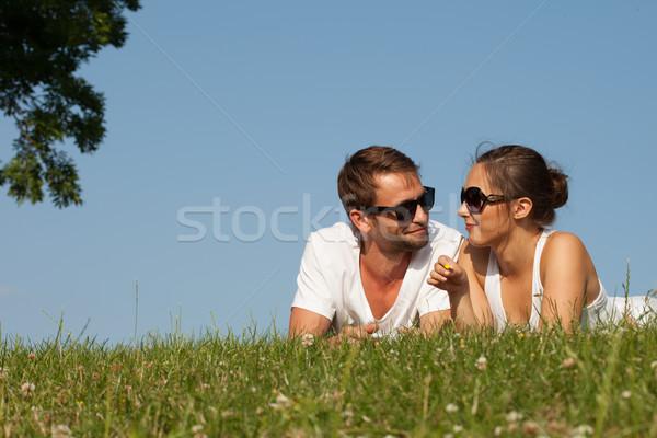 Fiatal pér fű romantikus vonzó napszemüveg felső Stock fotó © stryjek
