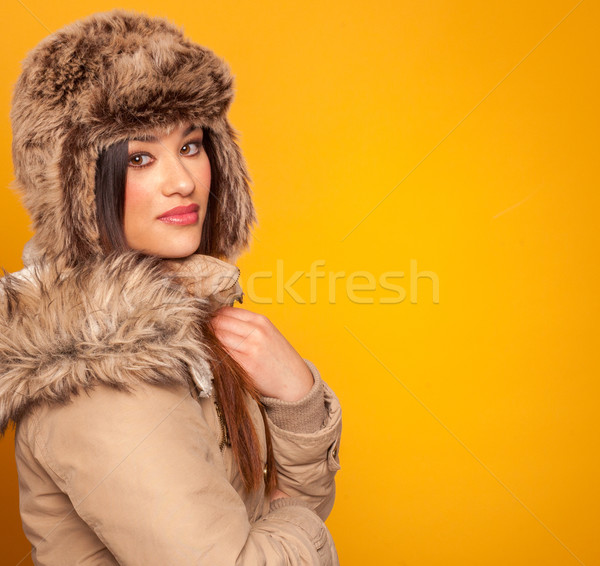 Beautiful young woman wearing a winter coat Stock photo © stryjek