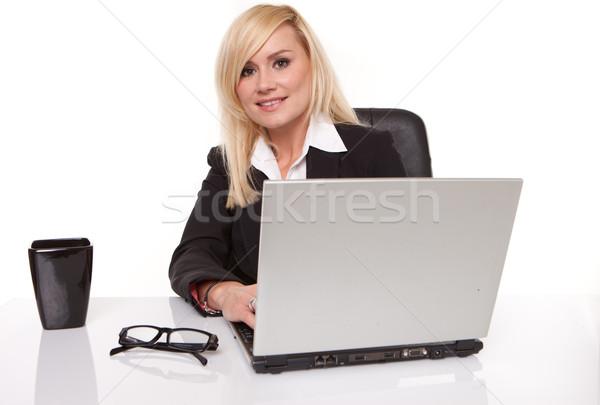 Efficient businesswoman working on her laptop Stock photo © stryjek