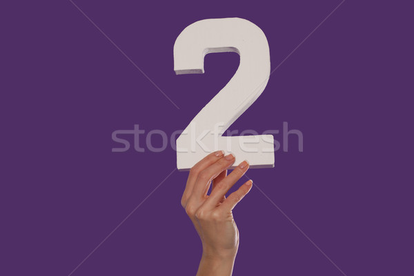 Female hand holding up the number 2 from the bottom Stock photo © stryjek