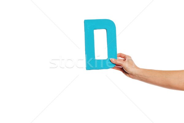 hand holding up the letter D from the right Stock photo © stryjek