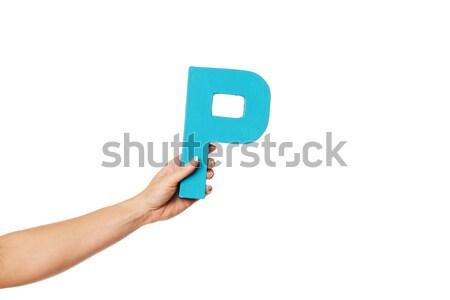 Kéz magasra tart o betű női nagybetű izolált Stock fotó © stryjek