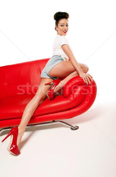 Leggy Retro Model On Red Leather Sofa Stock photo © stryjek
