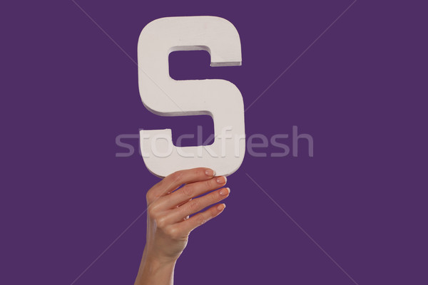Female hand holding up the letter S from the bottom Stock photo © stryjek