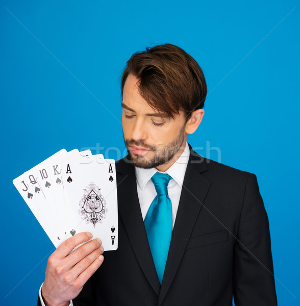Fiatal üzletember mutat kártyapakli póker arc Stock fotó © stryjek