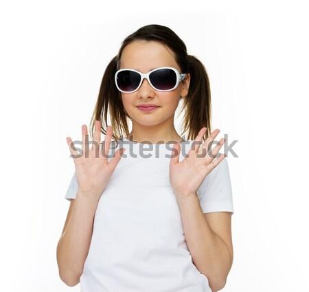 Smiling pretty young girl in trendy sunglasses Stock photo © stryjek
