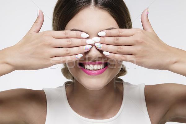 Schoonheid vrouw glimlachen verbergen ogen gel nagels Stockfoto © stryjek