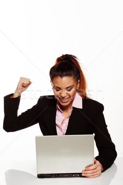 Frustrated woman punching her laptop Stock photo © stryjek
