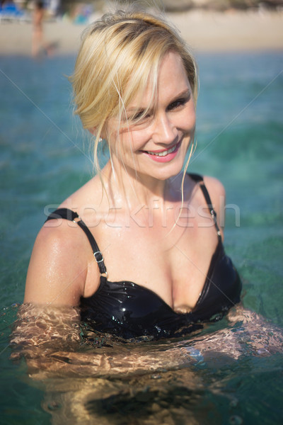 beautiful blonde woman swimming in the ocean Stock photo © stryjek