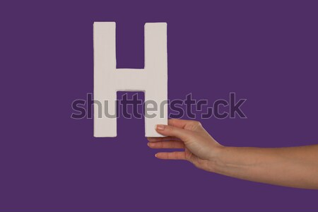 hand holding up the letter H from the right Stock photo © stryjek