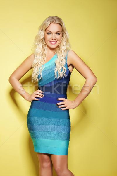 beautiful young woman with bright blue eyes wearing dress Stock photo © stryjek