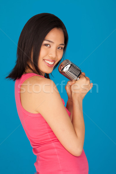 Pretty Young Asian woman with a microphone Stock photo © stryjek