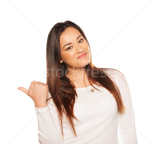 Smiling woman gesturing with her thumb Stock photo © stryjek
