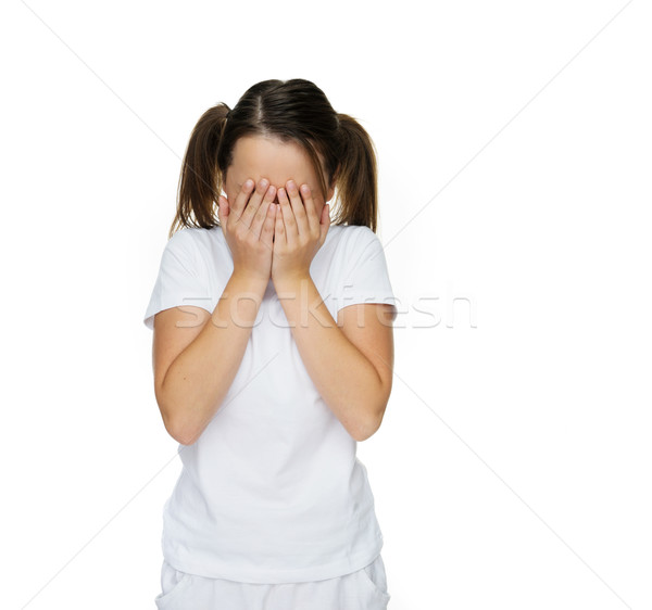 Young girl covering her face with her hands Stock photo © stryjek