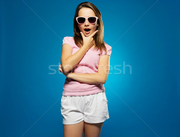 Fashionable young girl with a look of surprise Stock photo © stryjek