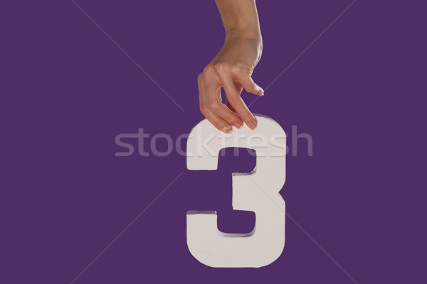 Female hand holding up the number 3  from the top Stock photo © stryjek