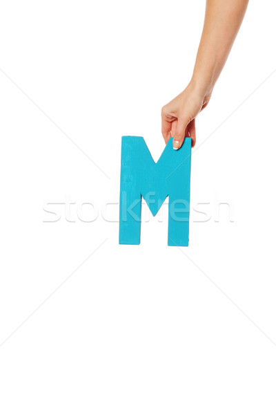hand holding up the letter M from the top Stock photo © stryjek