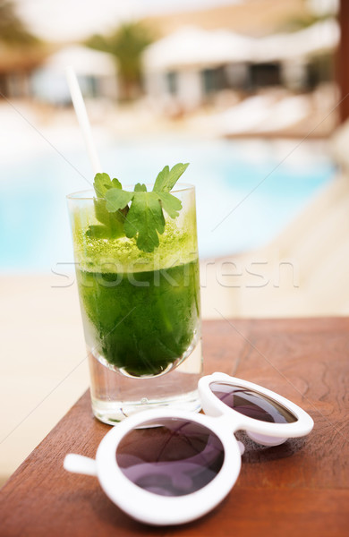 Sunglass and tasty detox cocktail next to swimming pool Stock photo © stryjek