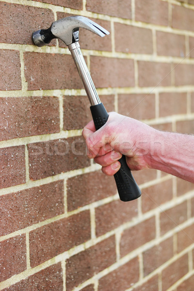 Man hitting a brick wall with a hammer Stock photo © stryjek