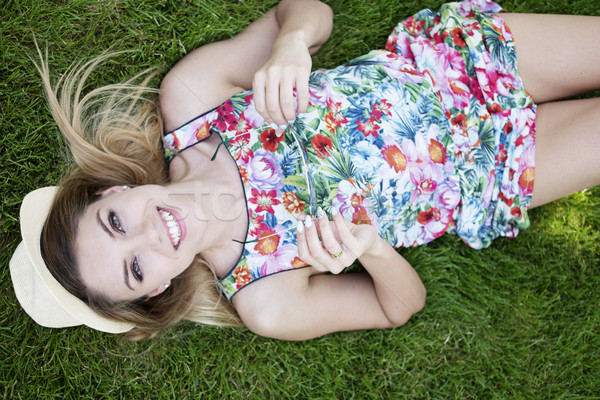 Smiling Pretty Young Woman Lying on the Grasses Stock photo © stryjek