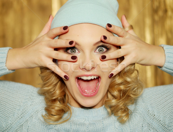 Surprised or shocked woman with blue eyes Stock photo © stryjek
