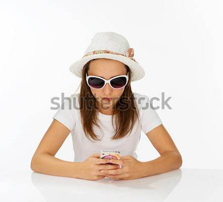 Beautiful little girl in a hat and sunglasses Stock photo © stryjek